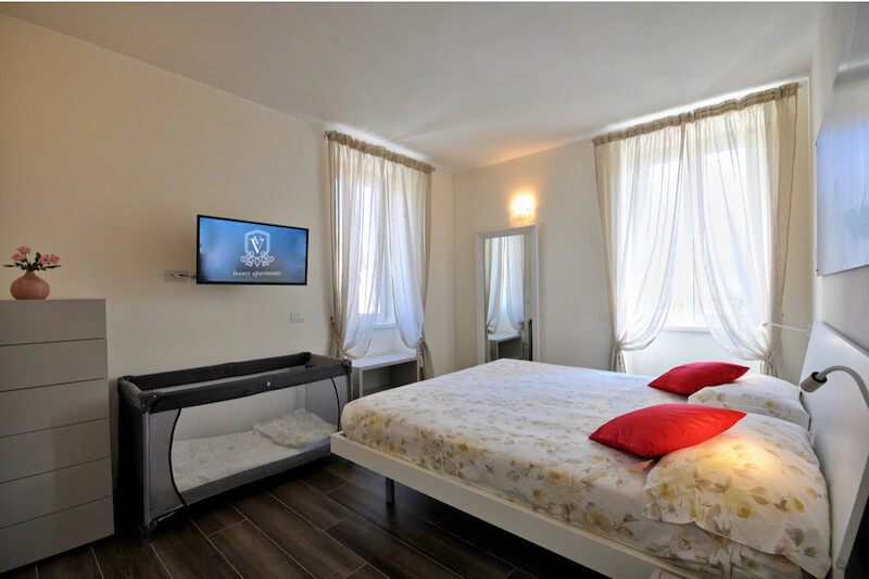 modern holiday apartment with double room and baby cot