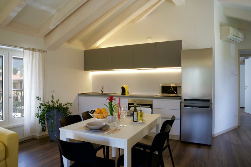 modern apartment with equipped kitchen, table and chairs