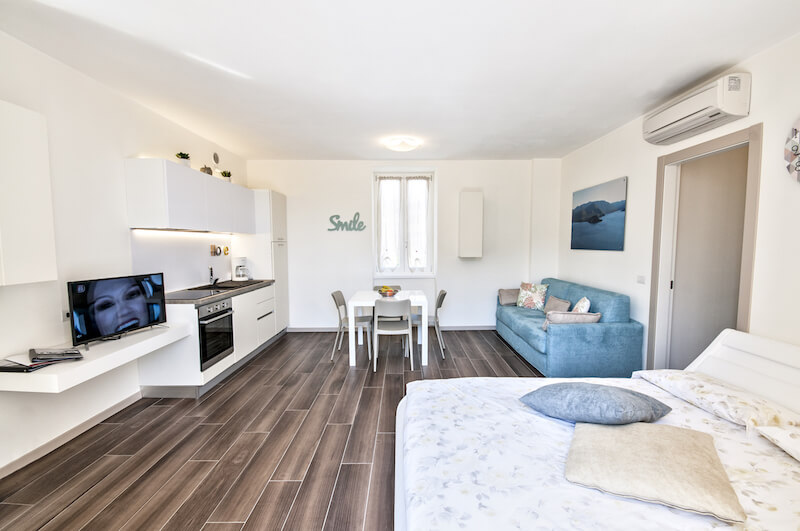 modern holiday studio with sofa bed, double bed, equipped kitchen and TV