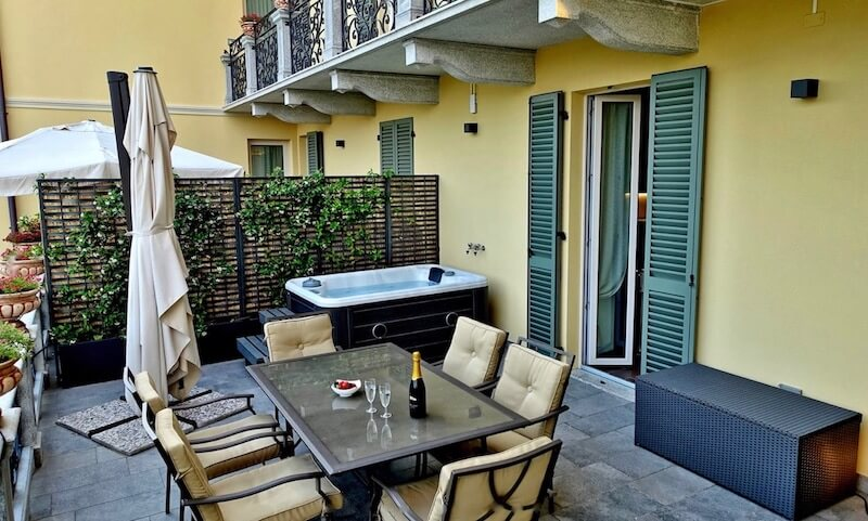 terrace with table, chairs, umbrella and private jacuzzi
