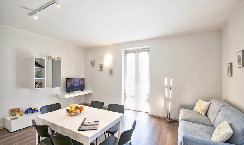 holiday apartment with table and chairs, sofa bed, TV and access to the terrace