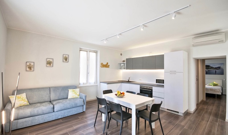 holiday apartment with sofa bed, table and chairs and equipped kitchen