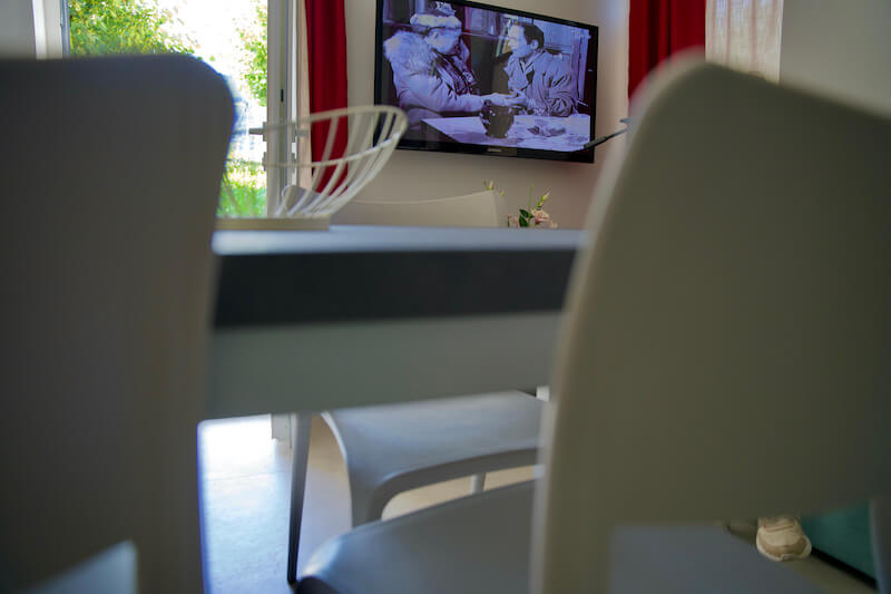 holiday apartment with table and chairs and TV